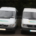 Two of our mini buses parked up